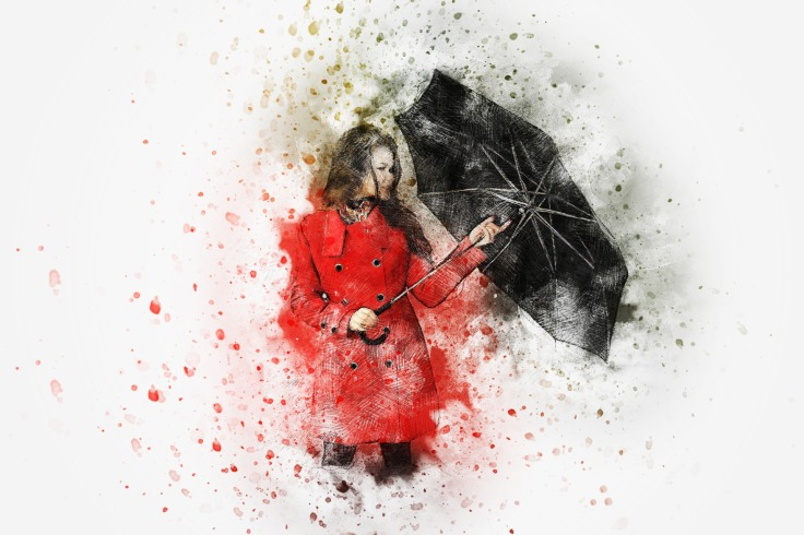 a woman in a red coat holding a black umbrella
