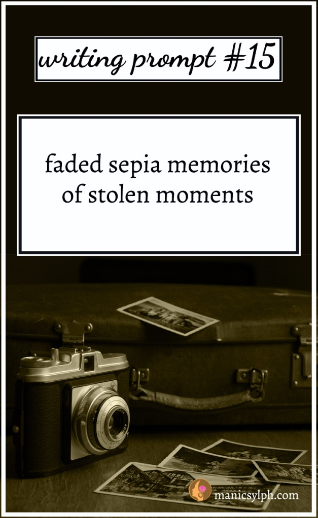 old camera and photographs with writing prompt written on it
