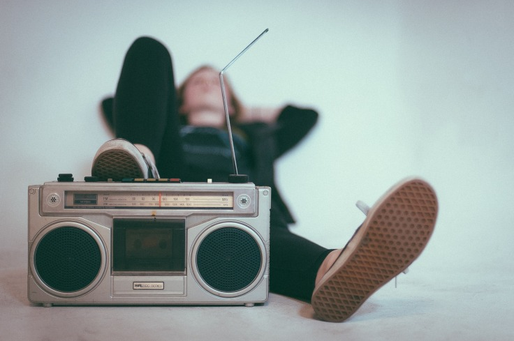 A person listening to radio