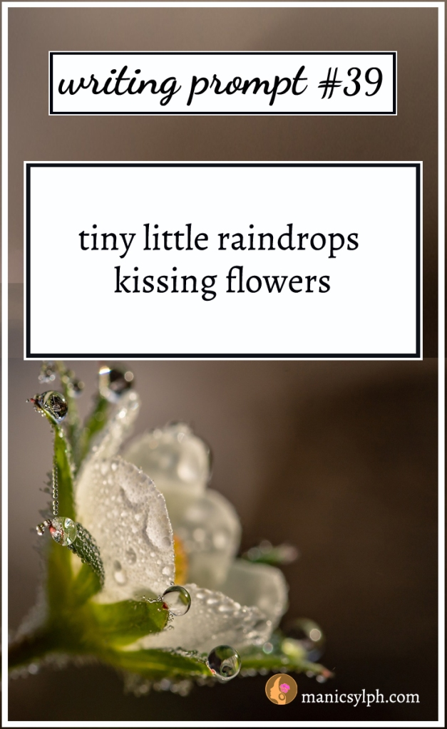 A white flower with raindrops and writing prompt 39 written on it
