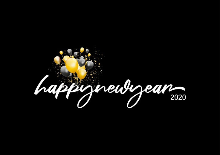 Balloons on black background with Happy New Year 2020 written on it