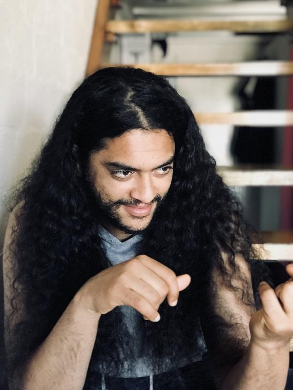 Ismael Mansoor using sign language